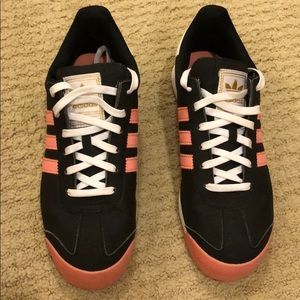 Black and pink Adidas tennis shoe